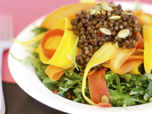 "Spicy Carrot ""Noodles"" with Black Lentil and Mixed Greens"